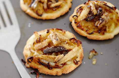 A nifty little wheat-free snack, these miniature pizzas are made with gluten-free flour, and topped with caramelised onions and chunks of sardine. Vary the toppings if you're feeling inspired, or swap the sardines for anchovies.