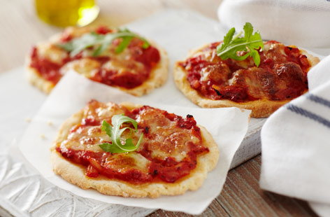 These gluten-free mini pizzas are a great way to get the kids involved in the kitchen. Making the dough from scratch is a lot of fun and each pizza base ends up being crisp and fluffy. Keep things simple with a margherita or your own choice of toppings.