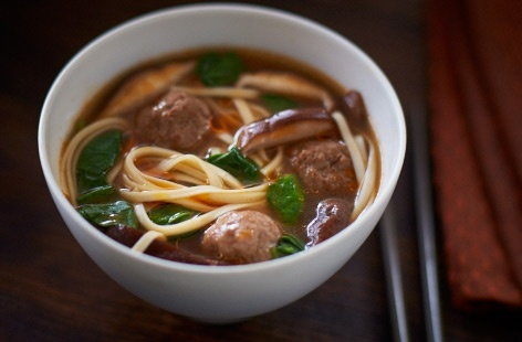 This warming and brothy Japanese soup makes for a filling meal, thanks to a combination of beef meatballs, spinach, shitake mushrooms and ramen noodles all spiced with Asian flavours