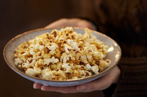 Making sticky toffee popcorn at home is easier than you think. Pop the popcorn as normal in a pan, and make a toffee sauce by melting butter, brown sugar and golden syrup together. Pour over the popcorn then voila, home movie nights just got that little bit more authentic.