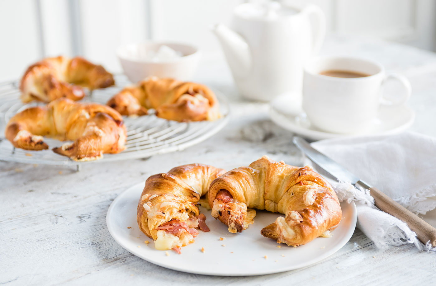 Cheese, sundried tomato and ham-stuffed croissants recipe