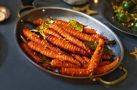 Supercharged with honey, garlic and bay, Jamie Oliver's caramelised hasselbacks are not your everyday carrot.