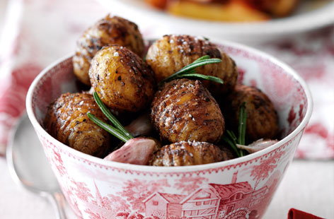 Hasselback potatoes with roasted garlic and rosemary HERO