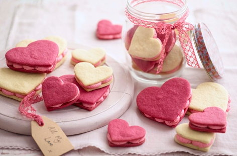 Say 'I love you' with these cute heart-shaped sandwich cookies, filled with a delicious pink buttercream