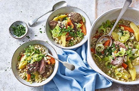 This authentic Irish stew takes care of itself, leaving you with more time to enjoy the craic with your guests. Tender lamb cutlets are seared then thrown into a pot with stock, potatoes, carrots, leeks, onions, pearl barley, then cabbage. Serve with spring onions and parsley for fresh contrast.