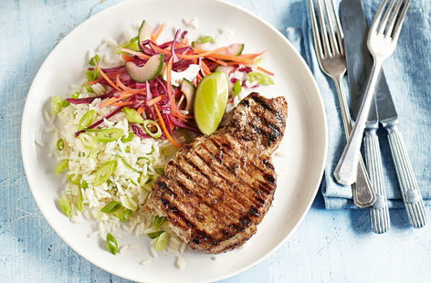 Jerk pork chops with lime rice and slaw