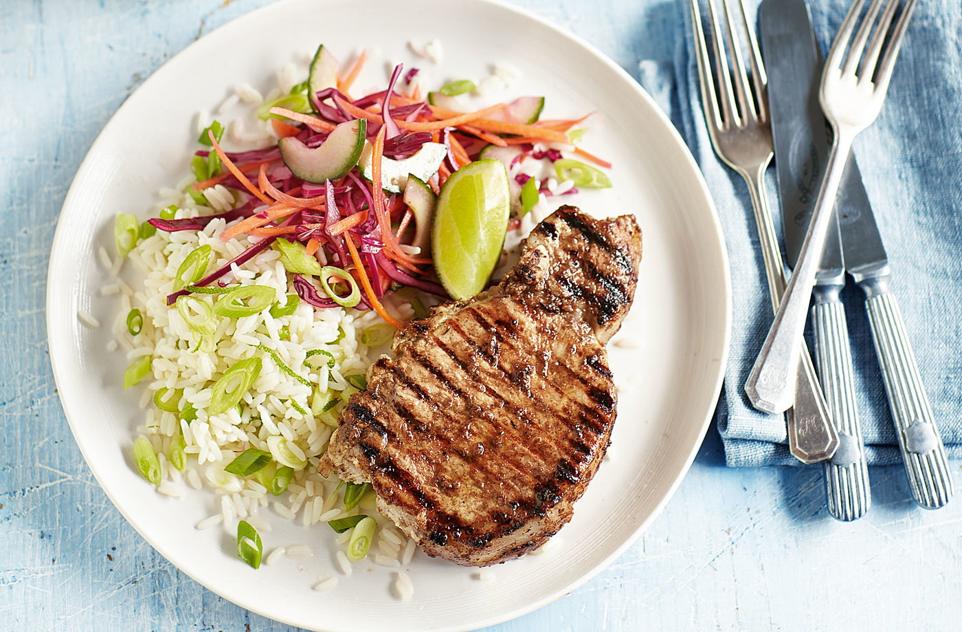 Jerk pork chops with lime rice and slaw recipe