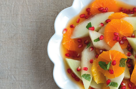 Melon, pomegranate and tangerine fruit salad