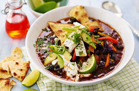 This rich soup is packed with fiery flavour, with creamy black beans, zesty lime and crispy corn tortilla strips