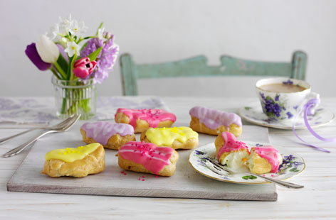 Mini eclairs with coloured icing