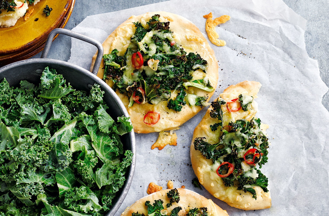 Mini kale, gouda and chilli pizzas
