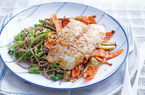 Fuel the family with this nourishing yet quick and simple to create Japanese fish dish with flavour-packed noodles and shredded greens.