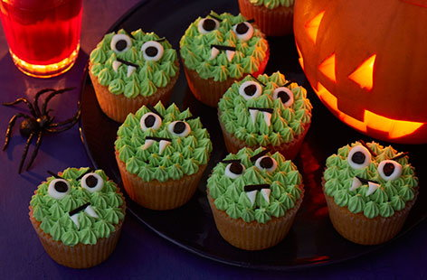Toothy green monster cupcakes