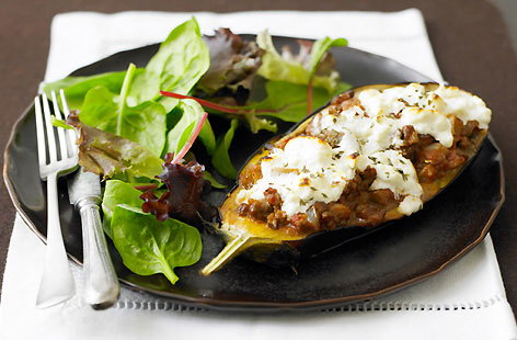 An updated version of the ever popular classic Greek dish, moussaka. Here halved aubergines, are stuffed with delicious, warmly spiced mince lamb, then baked, and topped with feta and greek yoghurt. Serve with a green salad on the side.