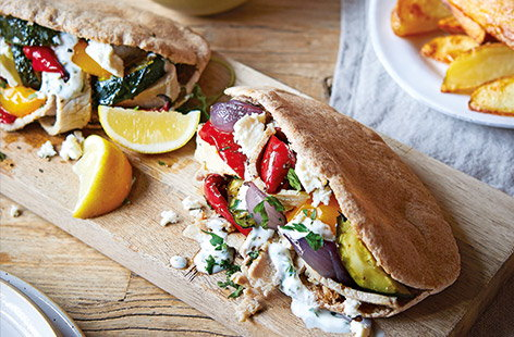 This easy one-tray recipe is ideal for a family dinner, pack your pittas full of tender pork and vegetables