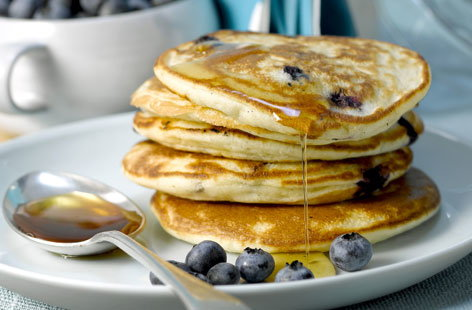 These classic blueberry pancakes are perfect brunchtime treat. Light and fluffy American-style pancakes are studded with juicy blueberries and best served with a drizzle of maple syrup - plus they have the bonus of being totally dairy-free.