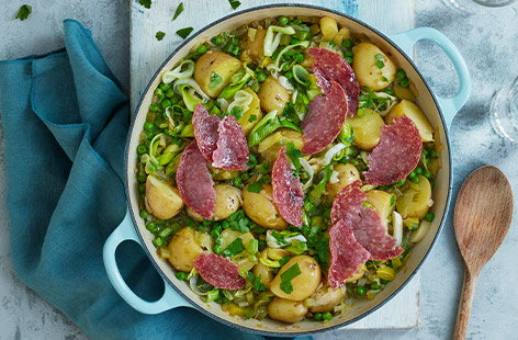 Pea and potato stew with crispy salami