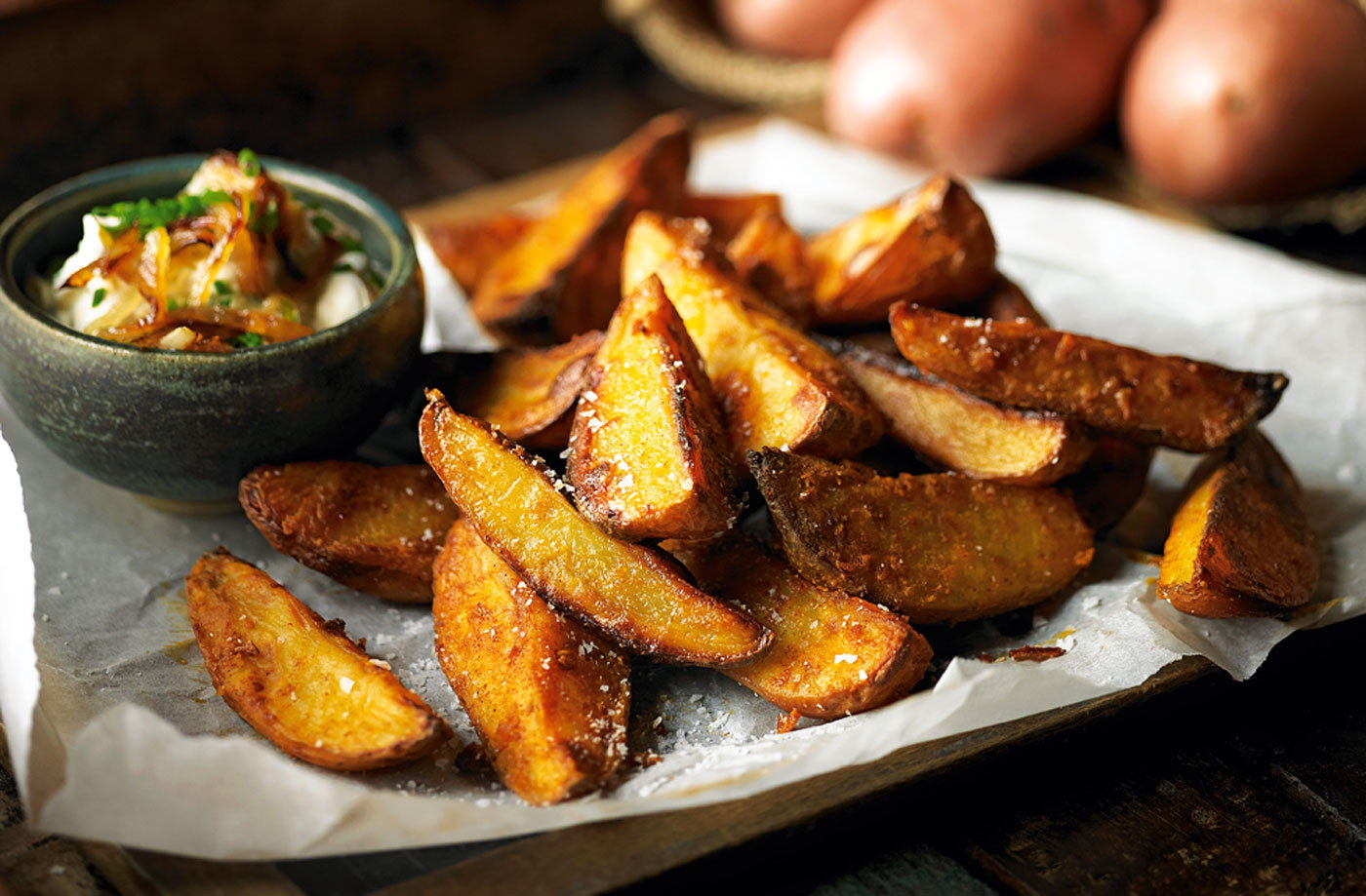 Spicy potato wedges with onion, chive and sour cream dip recipe