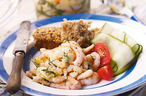 Potted prawns with tomato and cucumber salad