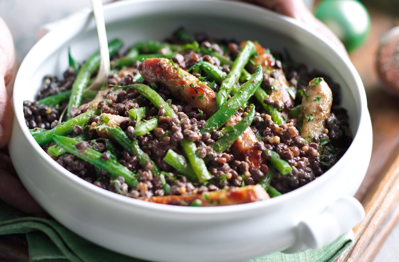 Puy lentils with chipolatas, green beans and sweet mustard dressing recipe