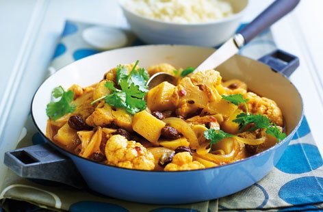 Cauliflower cooks in moments and is perfect in spiced vegetarian tagines. For this moroccan-inspired dish, softened onion, potato, cauliflower and olives simmer in stock until tender. Serve with fresh coriander and fluffy couscous.