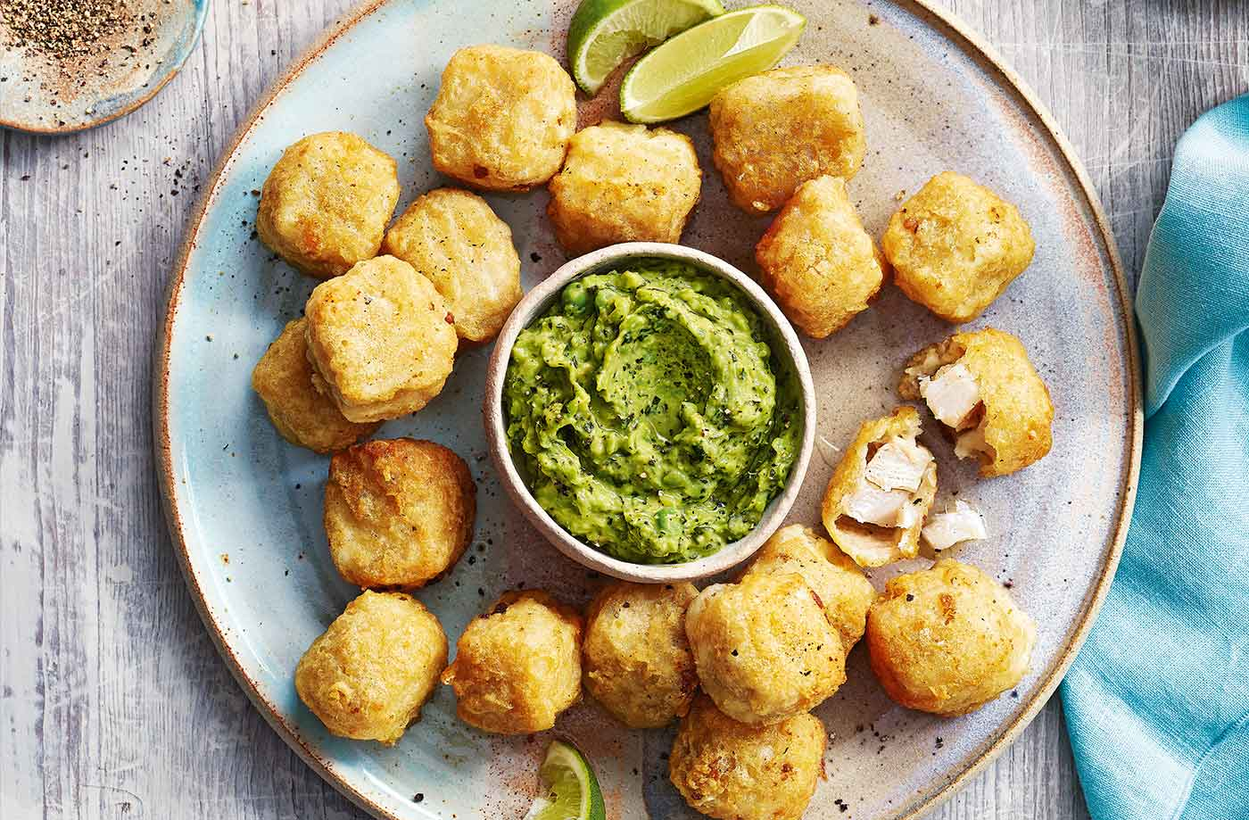 Fish nuggets with avocado and pea dip recipe