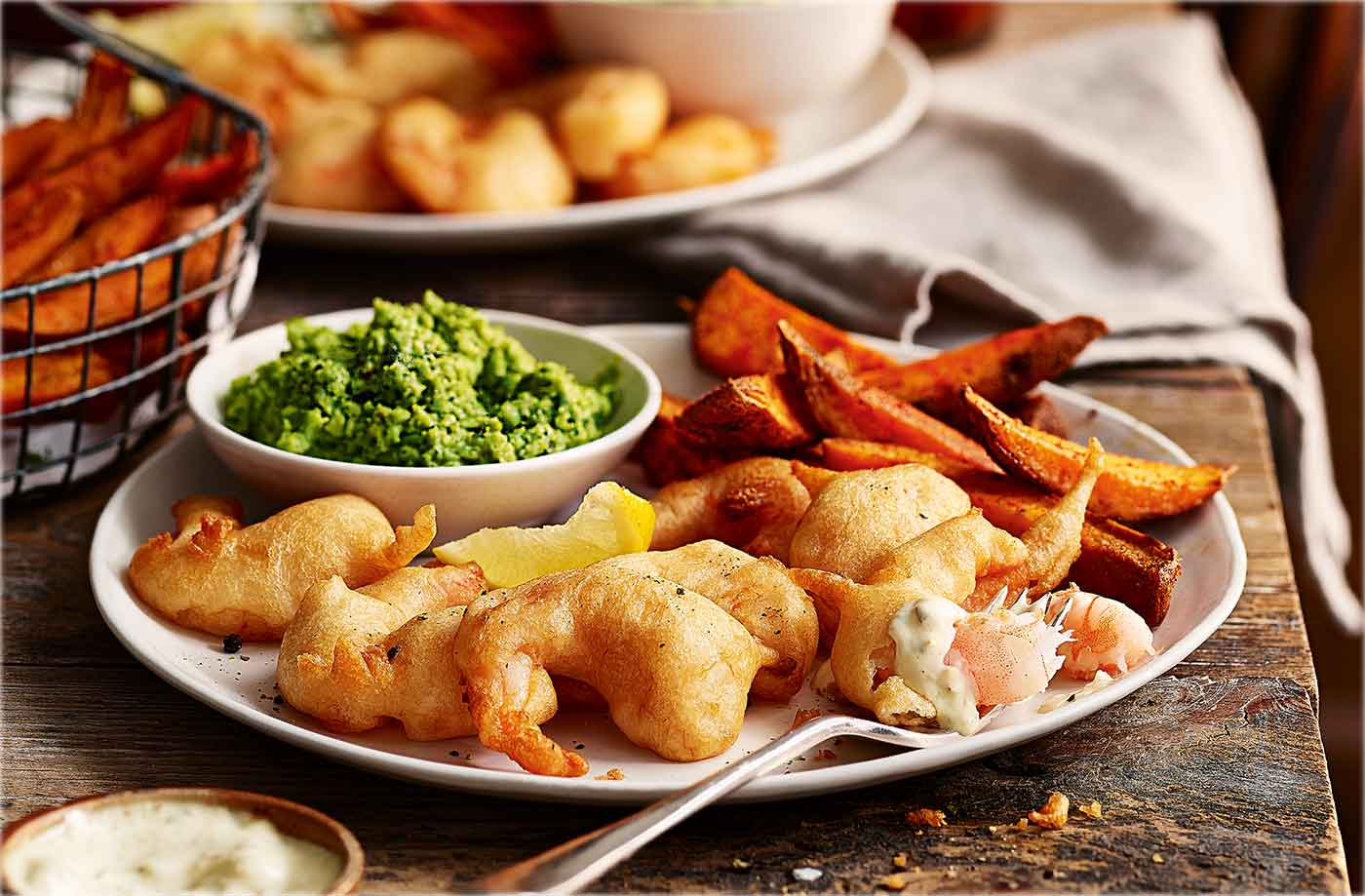 Beer Battered Scampi With Sweet Potato Chips And Mushy Peas