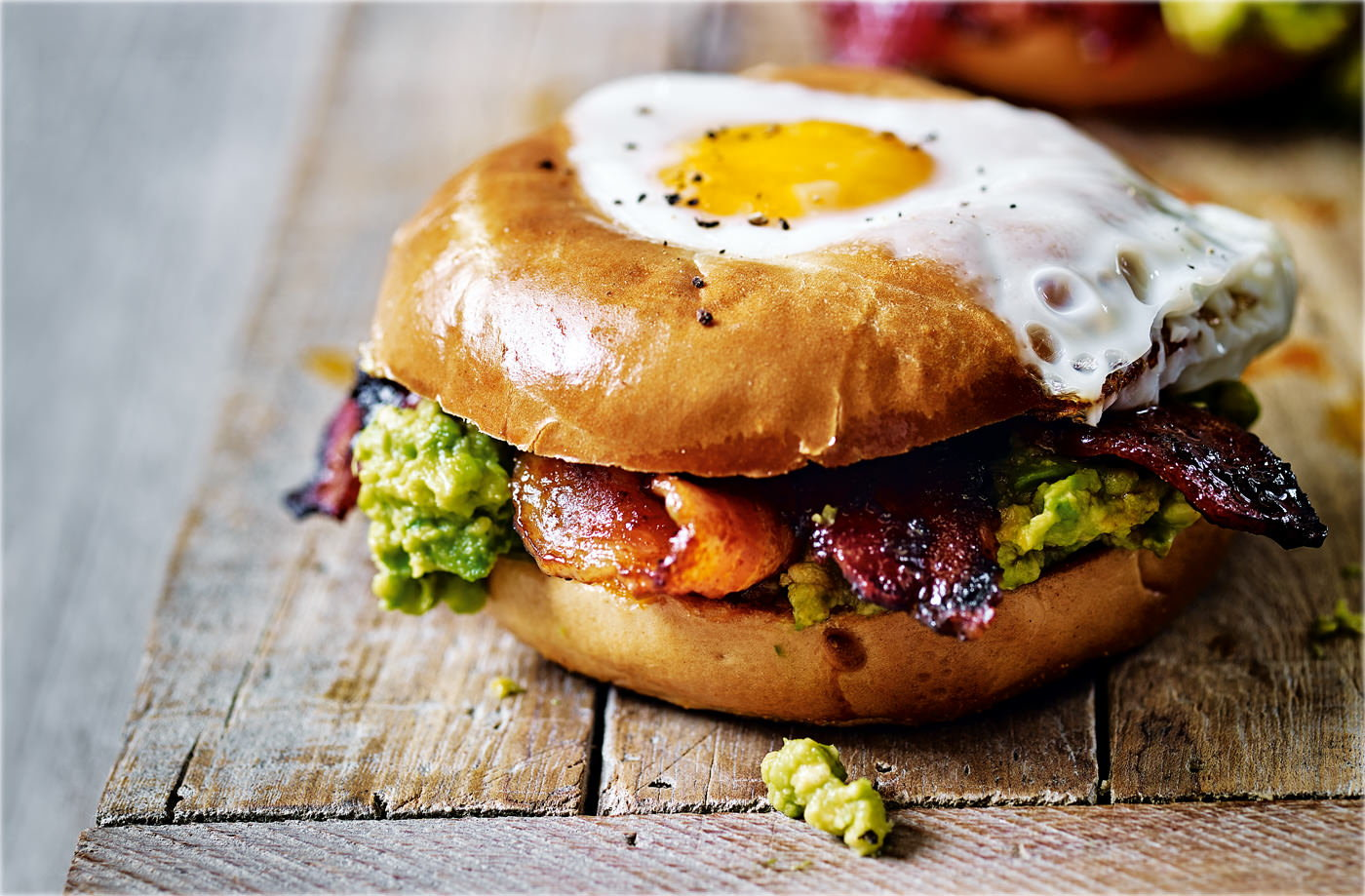 Egg in a hole with spicy bacon and guacamole recipe