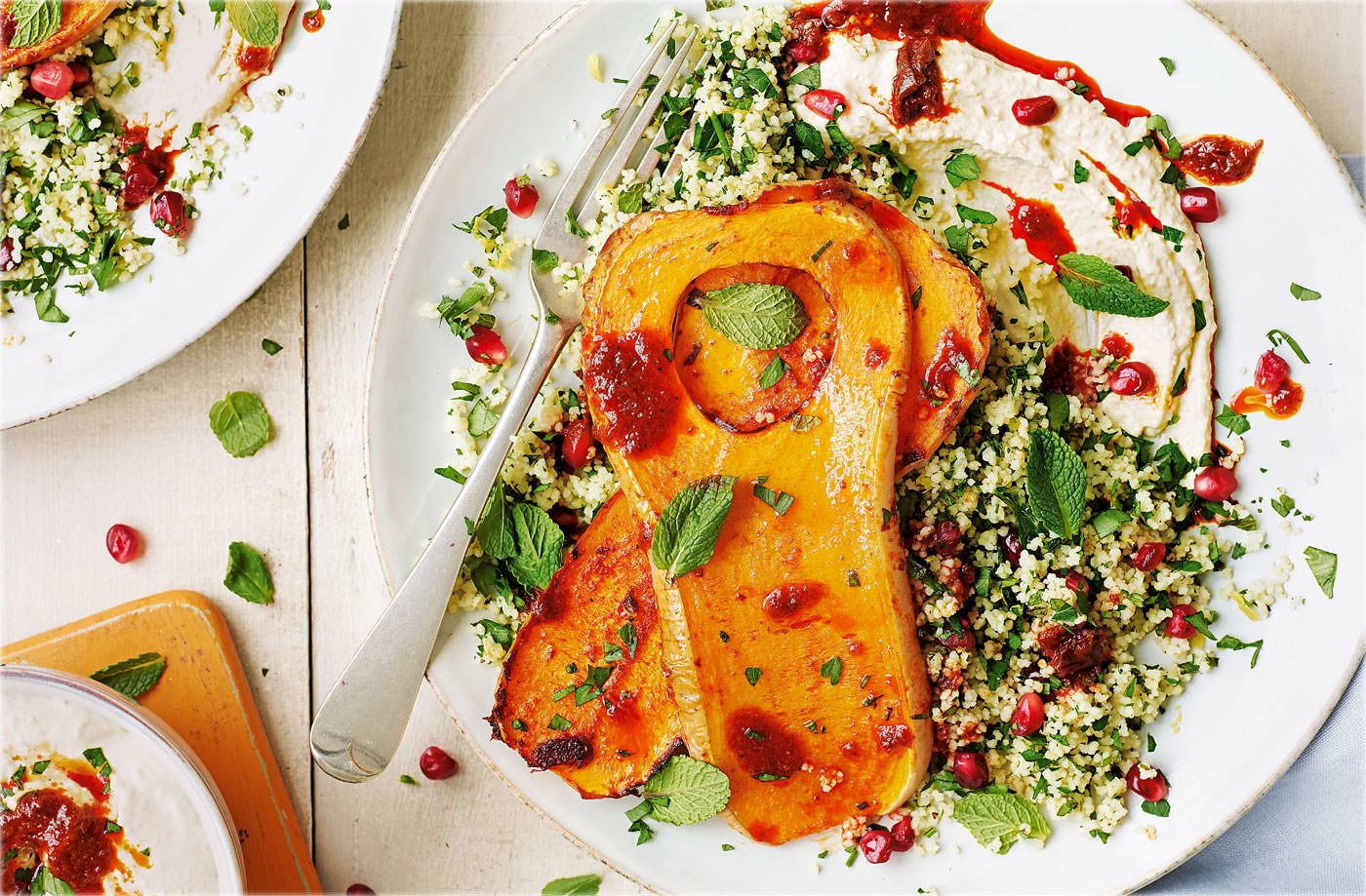 Butternut squash steaks with houmous and jewelled couscous