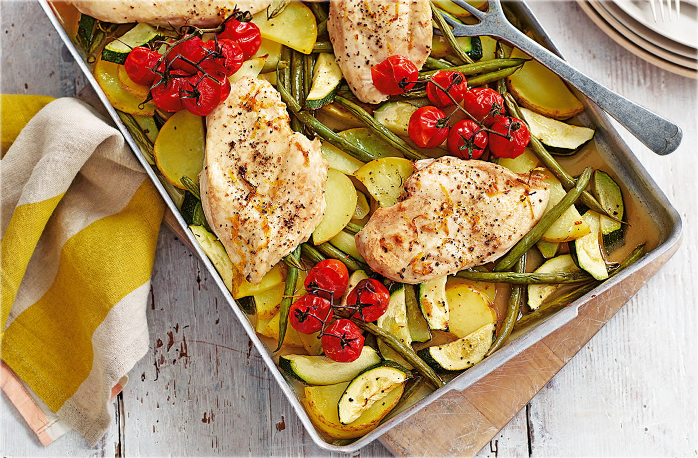 Chicken traybake with vine tomatoes and courgettes recipe