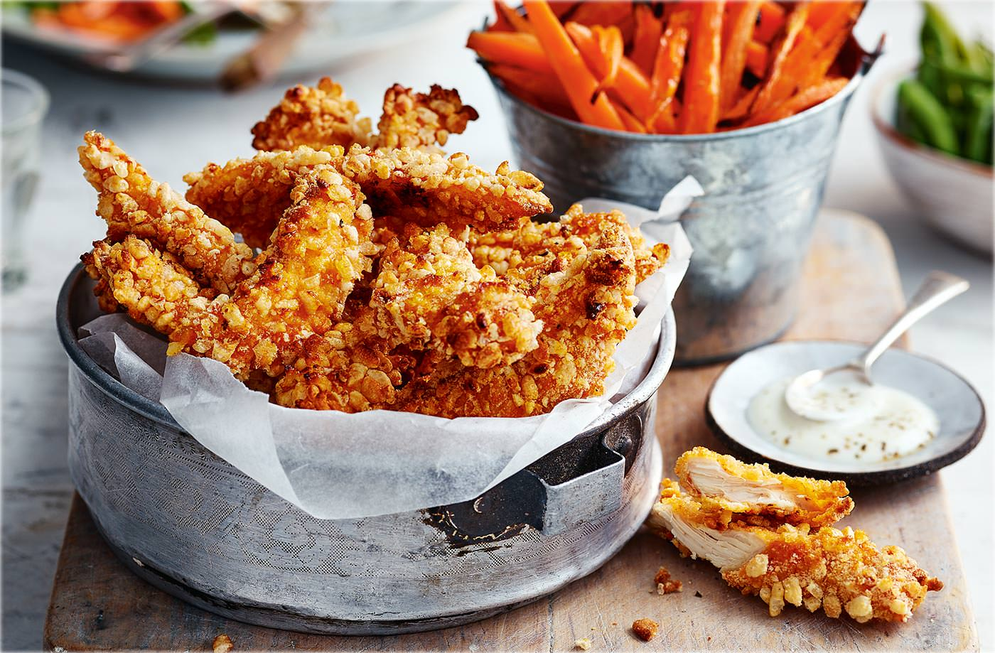Crunchy chicken goujons with carrot 'fries'