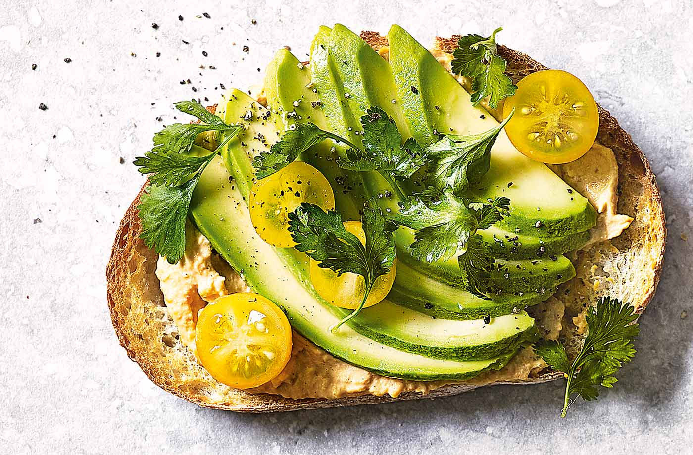 Houmous, avocado and yellow tomatoes toast topper recipe