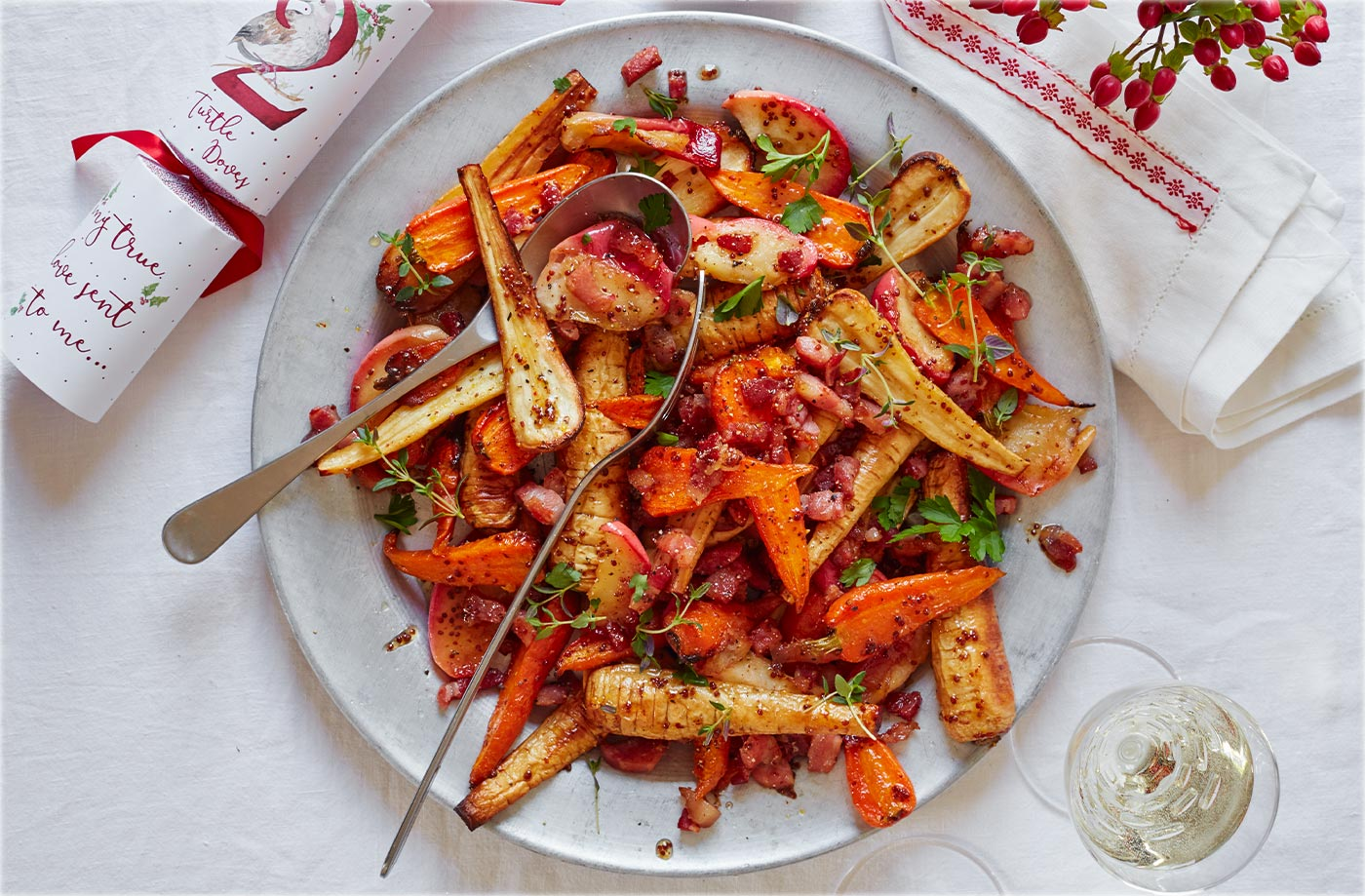 Roasted carrots and parsnips with bacon and apples