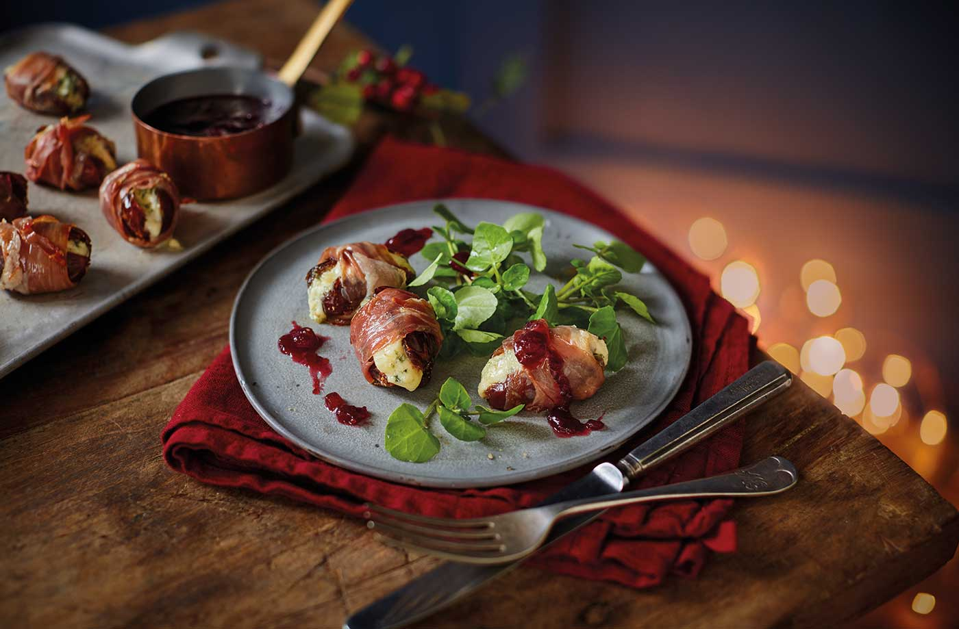 Prosciutto wrapped dates with port and cranberry sauce