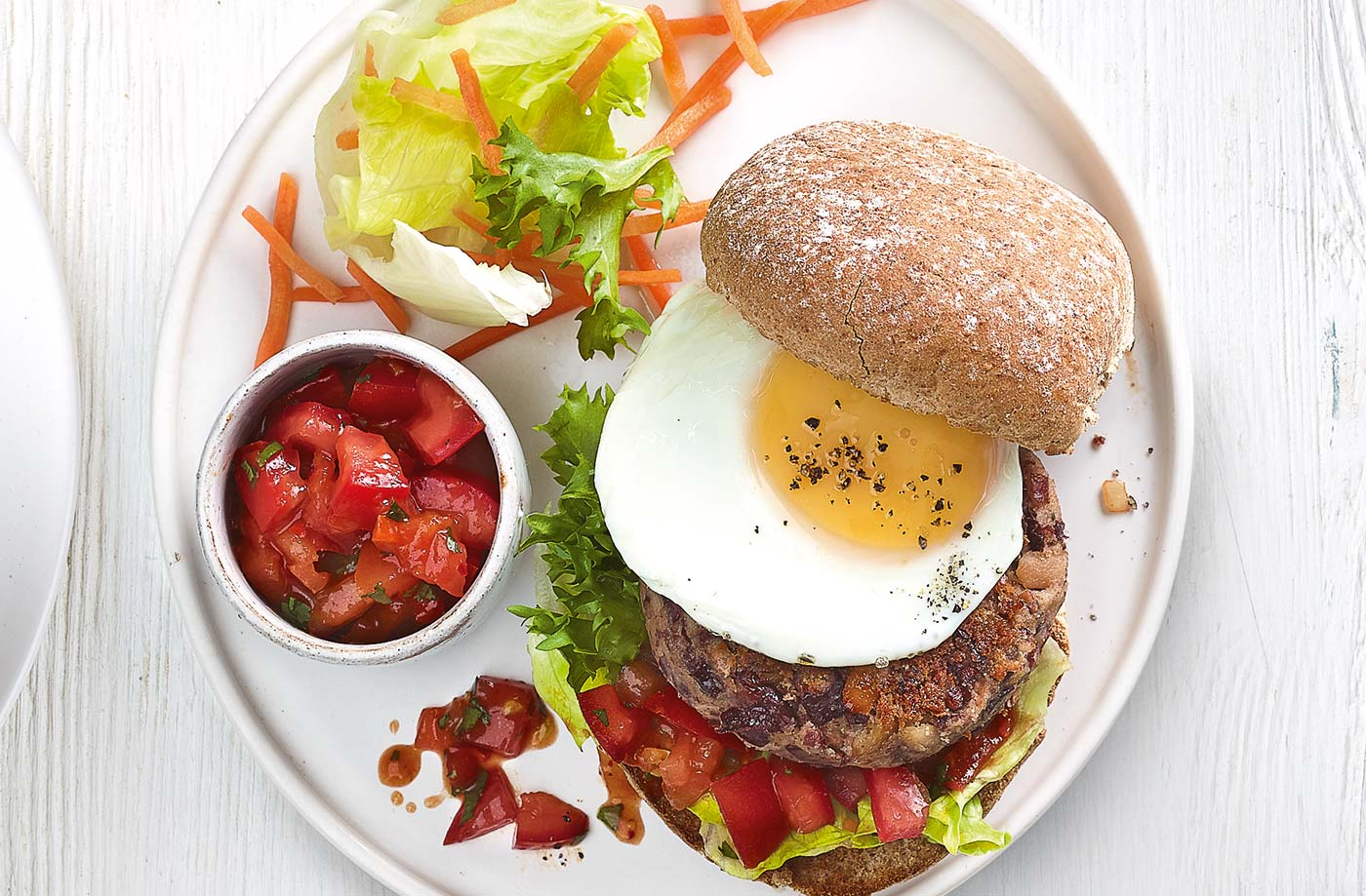 Egg-topped veggie bean burgers recipe