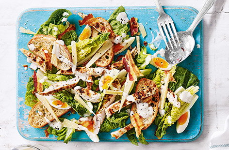 A few clever twists cut the calories in this classic Caesar salad for a lighter summer lunch keeping all the best elements – crisp pancetta, tender chicken and plenty of lettuce with a creamy buttermilk dressing.