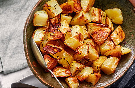 Crispy roast potatoes are always an irresistible side dish. Try this recipe with fragrant rosemary and no need to parboil the potatoes, making them extra simple