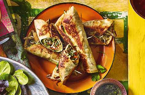 These Indian-inspired brunch wraps are packed with flavour throughout every bite: spiced mashed potato, fresh veg coleslaw, chilli eggs and tangy mint chutney. The stuffed wraps are then fried until crisp for a delicious finishing touch.