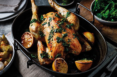 Roast chicken with basil and lemon salsa and garlic potatoes