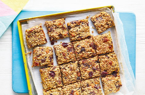 Golden chewy flapjacks are an irresistible teatime treat, and these flapjacks have been given an extra fruity twist with juicy grated pear, dried apricots and cranberries for a colourful traybake perfect for picnics.