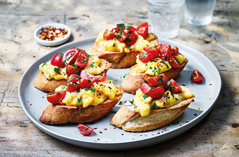 Breakfast, brunch or even lunch, these tasty egg and tomato topped toasts are perfect for feeding a crowd as it's easy to make a big batch in one go. You can get lots of slices out of one single baguette, ready to be topped with creamy Parmesan eggs.