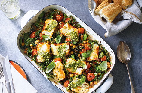 Halloumi is a staple of summer lunches – try something different with this super-easy one-tra bake. The halloumi turns wonderfully golden when grilled with chickpeas, kale and tomatoes. Finish with a drizzle of fresh pesto and serve with crusty bread.