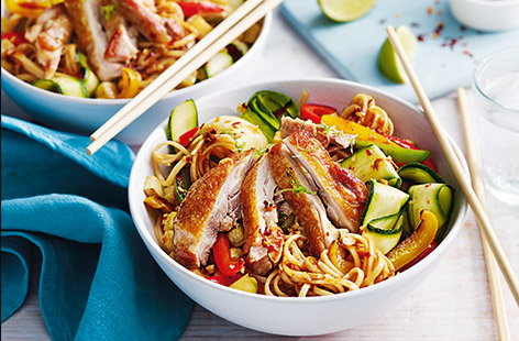 Pairing golden, crispy chicken thighs with sweet peppers, courgette ribbons, and egg noodles, gives a hearty stir-fry recipe that's great for busy weeknights