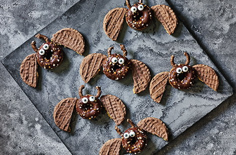With edible eyes, pretzel ears and biscuit wings, these adorable chocolatey treats are perfect for a kids' Halloween party.