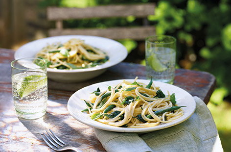 This clever spaghetti recipe uses tinned beans to make a super-quick, creamy dairy-free sauce to coat the pasta. Flavoured with lemon and garlic, this easy vegan pasta recipe is also packed with summer veg for a filling midweek meal.