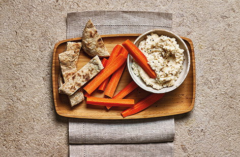 Upgrade your snack game with this creamy garlic and butter bean dip that's made extra creamy with Greek-style yogurt.