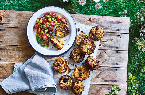 These tender cornbread muffins are the perfect portable picnic snack. Melting Cheddar cheese, sweet sundried tomatoes and spicy jalapeños pack these buttery muffins with flavour for a delicious (and veggie) lunchtime alternative to standard sandwiches.