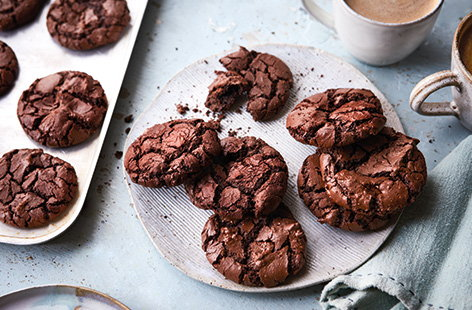 This might just be the ultimate chocolate cookie recipe. Rich, dark and intensely chocolatey, these soft-in-the-middle, crisp-on-the-outside cookies have a gorgeous crinkled top revealing their fudgy texture.