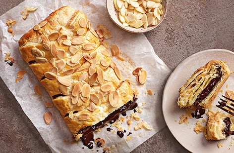 Get your chocolate fix with this super simple chocolate pastry recipe that makes a treat brunch or dessert, served warm with the chocolate oozing out of the flaky, golden puff pastry.
