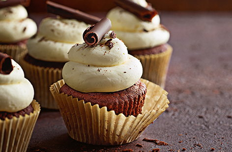 These zesty chocolate orange cupcakes, topped with a swirl of buttercream and glossy chocolate curl, are the perfect bake for an afternoon treat or special occasion. Making your own chocolate curls is sure to impress and an easy decoration to try at home.